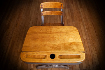 a vintage wooden school desk and chair